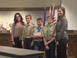 Boy Scout Troop 1865 stands with Sphere One Aviation Owner Brenda Blackburn and Cedar City Mayor Maile Wilson after they were presented with a check of $1,383 from Sphere One Aviation for their help with a fly-in breakfast, Cedar City, Utah, Oct. 8, 2014 | Photo by Holly Coombs, St. George NewsThe fly-in breakfast was an event put on for the public to attend and for local pilots to fly into the Cedar City Airport by plane and enjoy a catered breakfast.