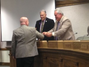 Cedar City Councilmen Don Marchant and John Black shake Danny Stewart's hand after he was announced as Cedar City's new economic development director, Cedar City, Utah, Oct, 8, 2014 | Photo by Holly Coombs, St. George News