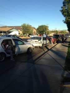 Four cars line the street of 700 South after being involved in an accident that caused damage to each car, St. George, Utah, Oct. 28, 2014 | Photo by Holly Coombs, St. George News