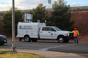 A Utah Department of Transportation worker  directing traffic after an accident at the intersection of Red Cliffs Drive and 1680 East on Oct. 9, 2014 | Photo by Devan Chavez, St. George News