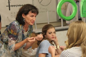 """Ellen Treanor, """"Triangle Power"""" director, gives some acting advice to a student on Smith, """"Triangle Power"""" producer, gives instructions to a student actor in Cedar City High School on Oct. 14, 2014 