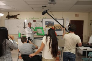 Matt Nickerson, playing the roll of the physics teacher in the production, acts out his roll as members of the production crew look on in  Cedar City High School on Oct. 14, 2014 | Photo by Devan Chavez, St. George News
