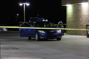 Crime scene tape surrounding the blue Toyota under investigation in connection with a homicide investigation in Cedar City, KB Express. 734 S. Main Street in at KB Express. 734 S. Main Street in Cedar City, relating to a homicide investigation, Cedar City, Utah, Oct. 21, 2014 | Photo by Devan Chavez, St. George News
