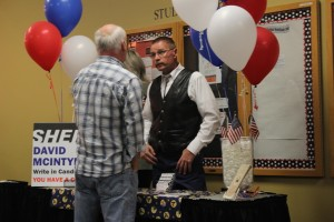 Call Rollins (left), KSUU-FM Station Manager, speaks with Sgt. Dave McIntyre (right) about the debate for Iron County Sheriff at SUU on Oct. 23, 2014 | Photo by Devan Chavez, St. George News