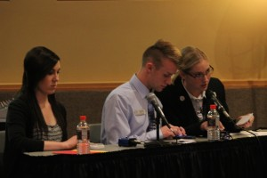 Leavitt Center Executive council member, Paige Christensen (right) asks a debate question to the candidates while fellow council members Matt Brown (center) and Alyssa Miller (left) prepare questions at SUU on Oct. 23, 2014 | Photo by Devan Chavez, St. George News