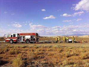 St. George firefighters stand on scene near the Corvette that crashed on state Route 7 just west of the River Road onramp, Utah, Oct. 25, 2014 | Photo by Aspen Stoddard, St. George News