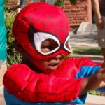 "Treyson, 2, channels his ""Spidey"" powers at the Spooky Town Fair carnival and fundraiser, St. George, Utah, Saturday, Oct. 25, 2014 