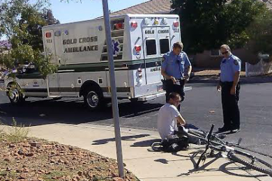 Steven Mason sits on the curb after getting hit by a car while riding his bike near 750 N. 2720 East in St. George, Utah, Oct. 19, 2014 | Photo by Aspen Stoddard, St. George News