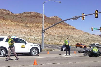 Responders tend to a motorcycle accident at the intersection of 5300 West and State Street in Hurricane, Utah, Oct. 15, 2014 | Photo by Aspen Stoddard, St. George News
