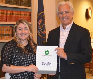 Mishaela, a student at Snow Canyon High School, receives a receives a savings account deposit certificate from Town & Country Bank President and CEO Bruce Jensen, St. George, Utah, Oct. 17, 2014 | Photo courtesy of Brent Bennett, St. George News