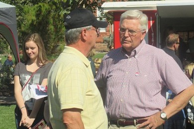 Rep. V. Lowry Snow (right) speaking with a prospective voter, St. George, Utah, Oct. 11. 2014 | Photo by Mori Kessler, St. George News