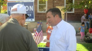 A constituent discusses issues with Washington County Commission candidate Victor Iverson, St. George, Utah, Oct. 11. 2014   Photo by Mori Kessler, St. George News