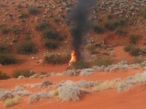 The Jeep Cherokee on fire just south of the intersection of state Route 7 and Sand Hollow Road, Utah, Nov. 2, 2014 | Photo courtesy of Casey Lofthouse, St. George News