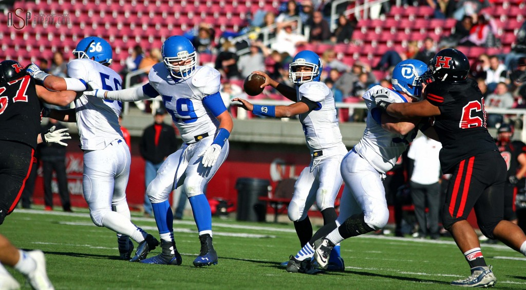 Dixie QB Ammon Takau looks for an open receiver, Dixie vs. Hurricane, 2014 3AA Football State Championship, Salt Lake City, Utah, Nov. 21, 2014 | Photo by Robert Hoppie, ASPpix.com, St. George News