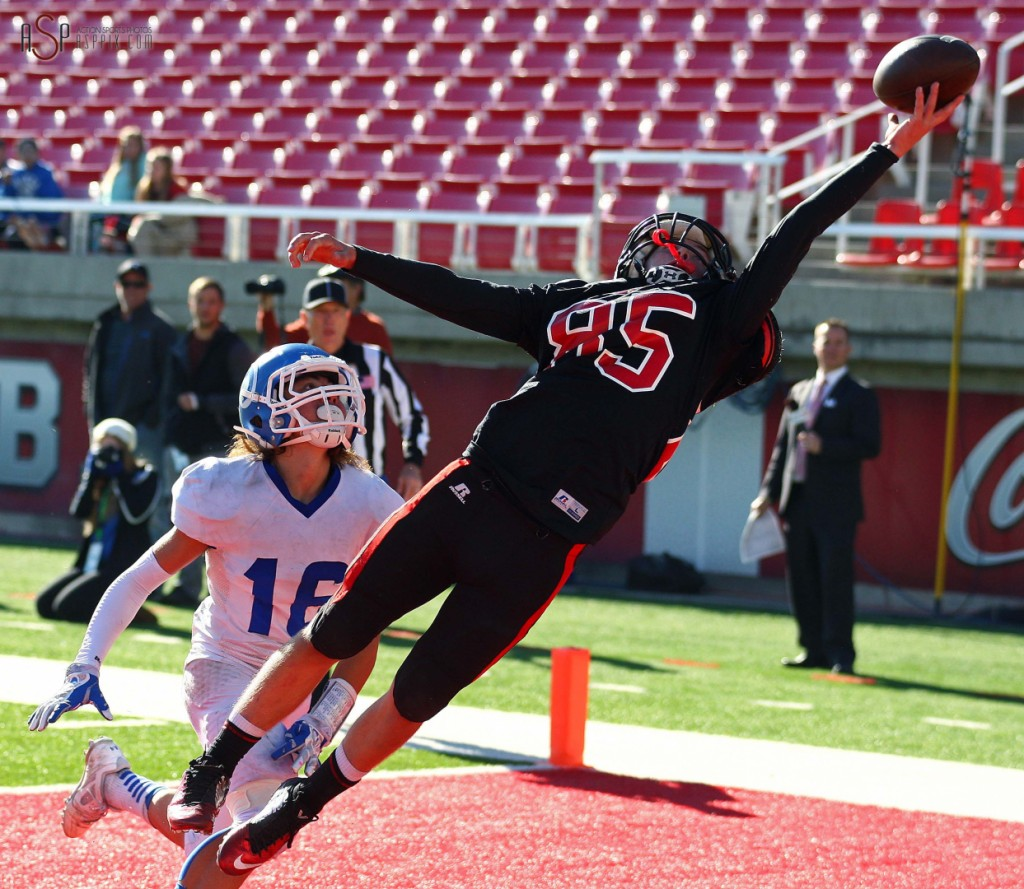 Hurricane WR Kyle Williams (85)reaches for a pass and just misses with Dixies Mason Oki defending, Dixie vs. Hurricane, 2014 3AA Football State Championship, Salt Lake City, Utah, Nov. 21, 2014 | Photo by Robert Hoppie, ASPpix.com, St. George News