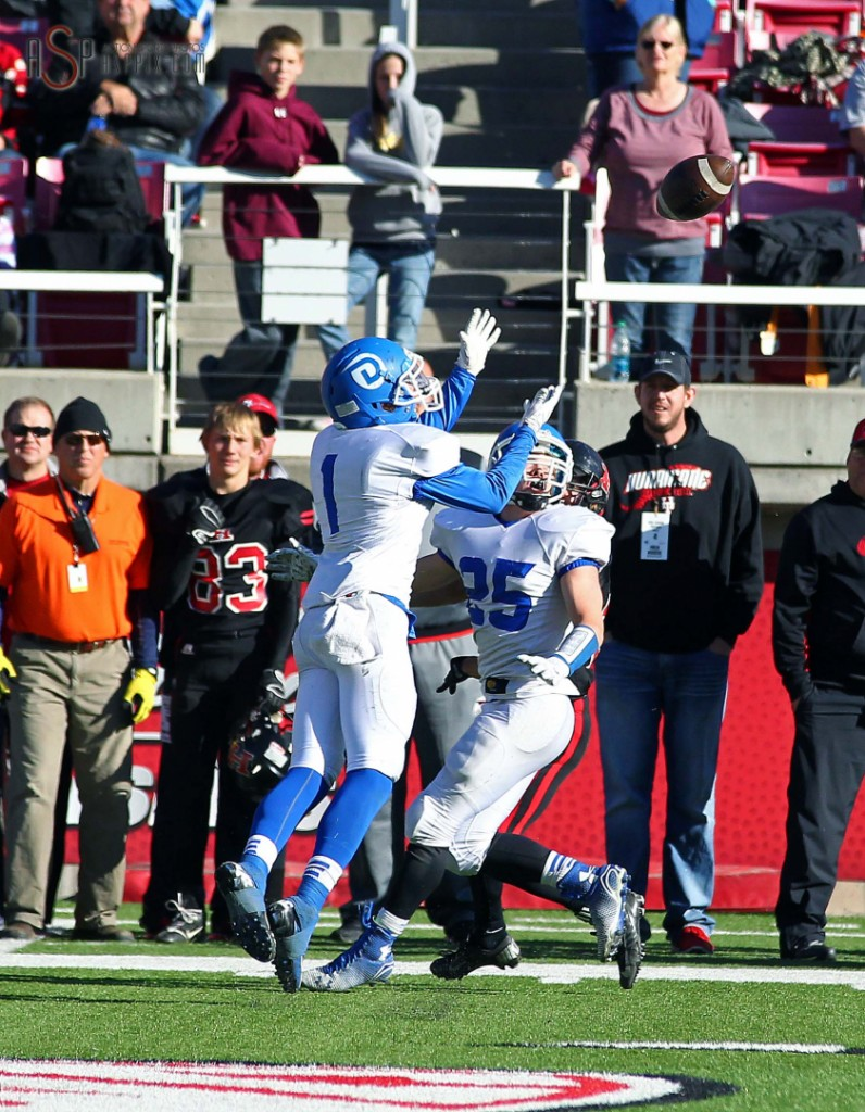 Dixie DB RJ Wilgar (1) intercepts a pass late in the game to seal the victory over Hurricane, Dixie vs. Hurricane, 2014 3AA Football State Championship, Salt Lake City, Utah, Nov. 21, 2014 | Photo by Robert Hoppie, ASPpix.com, St. George News