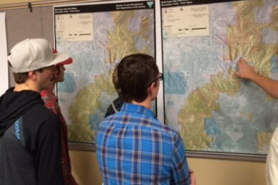 Dave Jacobson (right) points out the downhill trail portion of a proposed trail system. BLM open house at SUU's Sharwan Smith Student Center, Cedar City, Utah, Nov. 20, 2014 | Photo by Devan Chavez, St. George News