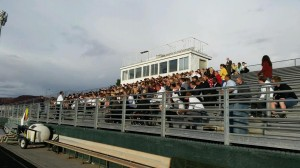 """A crowd gathers at the Snow Canyon High School football stadium for a """"break the fast"""" event after a day of prayer and fasting for Britton Shipp, St. George, Utah, Nov. 2, 2014 