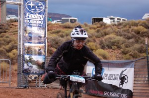 Lynda Wallenfels dismounts after the completion of another lap at the 25 Hours in Frog Hollow endurance mountain bike race, Virgin, Utah, Nov. 2, 2014 | Photo by Hollie Reina, St. George News