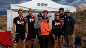 L-R Andy Kerlin, Josh Heaton, Ralph Reina, Stan Young, Hollie Reina, Bridger Wilson, Will Shake and Bart Finklea representing High Knees Cycling are all smiles before the start of the 25 Hours in Frog Hollow endurance mountain bike race, Virgin, Utah, Nov. 1, 2014 | Photo courtesy of Sandy Wilson, St. George News