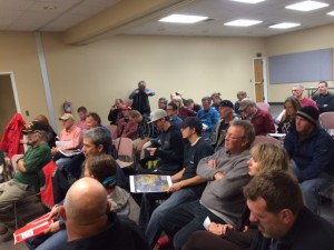Audience members listen as Dave Jacobson gives presents the BLM's proposed trail system, Cedar City, Utah, Nov. 20, 2014 | Photo by Devan Chavez, St. George News