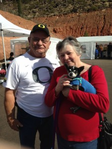 """Jerry and ReNee Sprague hold """"Earl,"""" whom they adopted at the Mega Pet Adoption event, St. George, Utah, Nov. 14, 2014 