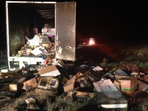 Burnt office supplies spill out of a Swift semi truck trailer after it caught fire on Interstate 15, Kanarraville, Utah, Nov. 19, 2014 |Photo by Holly Coombs, St. George News