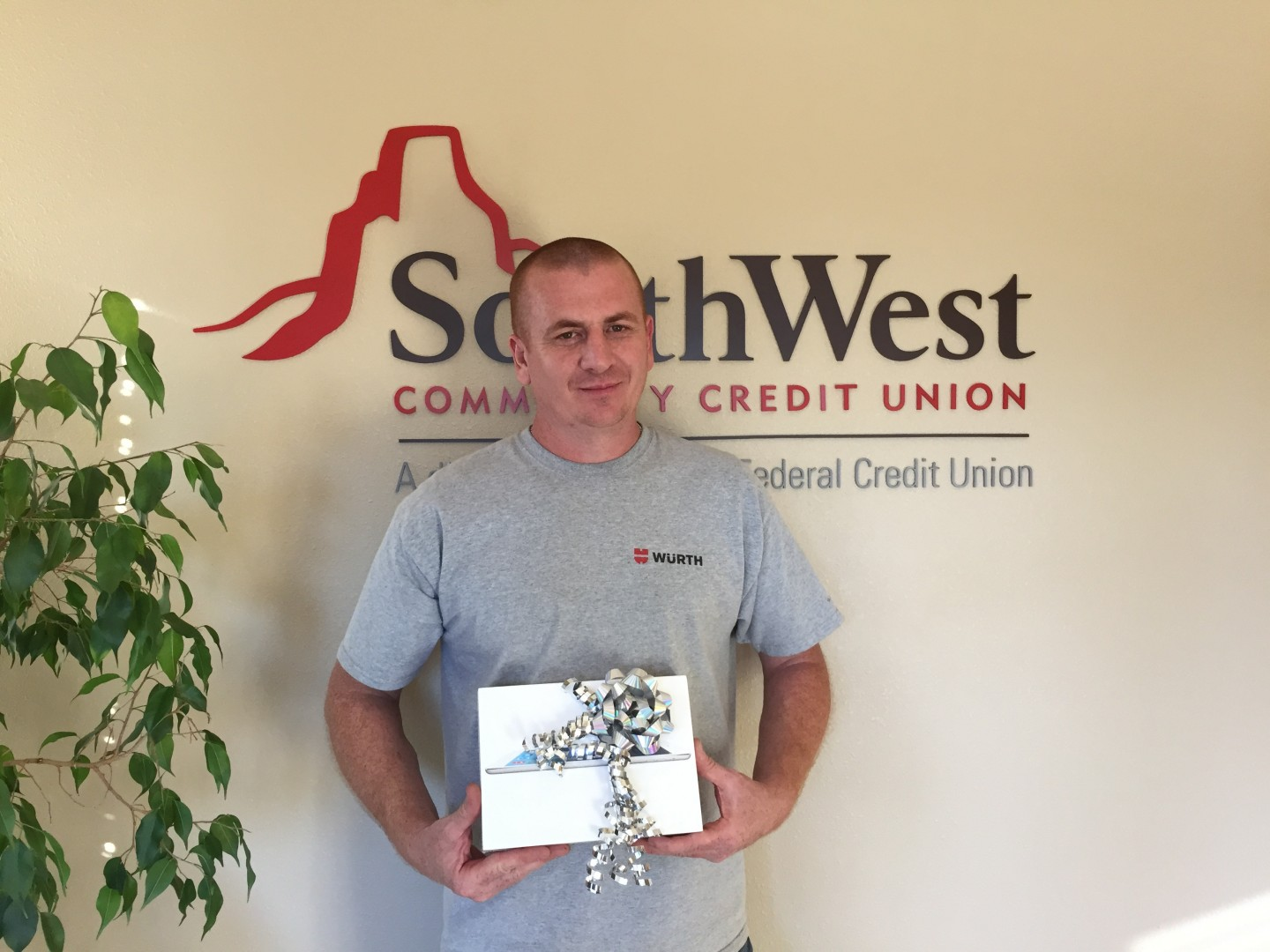 Ryan Carter holds the iPad he was awarded by SouthWest Community Federal Credit Union for his participation in the United Way Dixie Ball Drop for Charity on Oct. 24, St. George, Utah, Nov. 19, 2014 | Photo courtesy of Rebekah Pectol, St. George News
