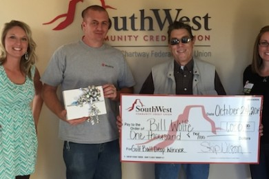 L-R: Rebekah Pectol, Randy Carter, Bill Wolfe, credit union employee. SouthWest Community Credit Union awards prizes to Carter and Wolfe, donated for the United Way Dixie Ball Drop for Charity. St. George, Utah, Nov. 19, 2014| Photo courtesy of United Way Dixie Executive Director Rebekah Pectol, St. George News