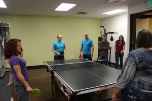 Members of the Sunwarrior accounting department take a break from work to play a game of tabletennis in the Sunwarrior rec room, Washington City, Utah, Nov. 11, 2014 | Photo by Devan Chavez, St. George News