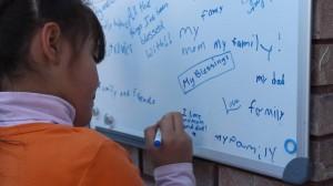 Sharon Jordan signs the gratitude board, Hildale, Utah, Nov. 29, 2014 | Photo by Leanna Bergeron, St. George News