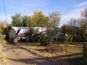 A cement truck crashes through fences and hits a power line before coming to a stop in the yard of a residence, Veyo, Utah, Nov. 13, 2014   Photo courtesy of Utah Highway Patrol, for St. George News