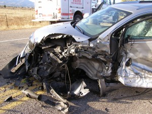 A Buick Enclave sustains severe damage after colliding with a cement truck, Veyo, Utah, Nov. 13, 2014 | Photo courtesy of Utah Highway Patrol, St. George News
