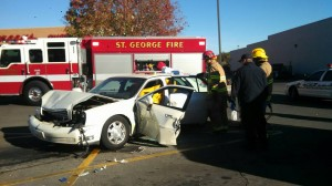 Firefighters work to extricate an 85-year-old woman from her car after she crashed  into two other vehicles in the Smith's parking lot, St. George, Utah, Nov. 18, 2014 | Photo by Mori Kessler, St. George News