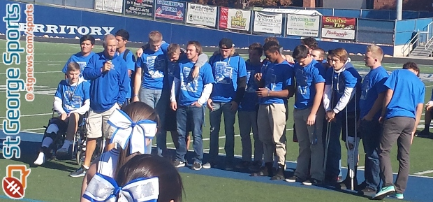 Coach Blaine Monkres (with his seniors) speaks at Walt Brooks Stadium during a rally to honor the Flyers' 2014 State Championship football team, St. George, Utah, Nov. 24, 2014. | Photo by Andy Griffin, St. George News.