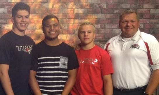 Coach Steve Pearson with (l to r) Kole Richins, Charlie Sefita and Tyson Yardley. | Photo by Andy Griffin, St. George News