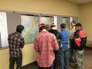 Community members gather around different maps of the proposed trail system, Cedar City, Utah, Nov. 20, 2014 | Photo by Devan Chavez, St. George News