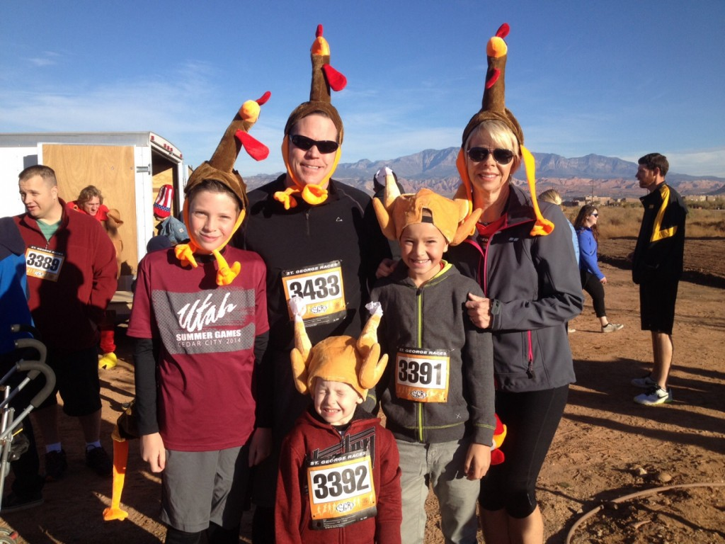 Front row: Lincoln Kelson. Middle Row: Carter Hugunin (L) and Dominic Kelson (R). Back row: Ted Hugunin (L) and Vicki Wilson (R). Family and friends don turkey hats and get set to participate in the Turkey Trot 5K and 1 mile fun run, St. George, Utah, Nov. 22, 2014 | Photo by Hollie Reina, St. George News