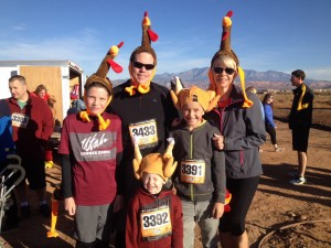 Front row: Lincoln Kelson. Middle Row: Carter Hugunin (L) and Dominic Kelson (R). Back row: Ted Hugunin (L) and Vicki Wilson (R). Family and friends don turkey hats and get set to participate in the Turkey Trot 5K and one mile fun run, St. George, Utah, Nov. 22, 2014 | Photo by Hollie Reina, St. George News
