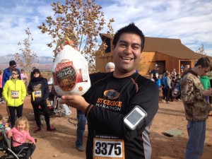 Manny Guarda shows off the turkey he won during the raffle at the Turkey Trot 5K and one mile fun run, St. George, Utah, Nov. 22, 2014 | Photo by Hollie Reina, St. George News
