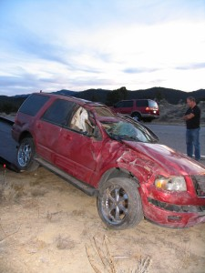 A red SUV occupied by two teenagers and two toddlers rolled along Highway 56 near New Castle, New Castle, Utah, Nov. 27, 2014 | Photo by Carin Miller, St. George News