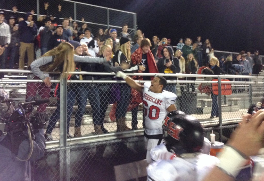 Quando Ieremia high-five fans, Hurricane at Juan Diego, Draper, Utah, Nov. 7, 2014 | Photo by AJ Griffin, St. George News