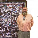 Zabriskie displaying the quilt he made while battling cancer, St. George, Utah, November 2014 | Photo courtesy of Michael Zabriskie, St. George News