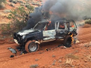 The Jeep Cherokee on fire just south of the intersection of state Route 7 and Sand Hollow Road, Utah, Nov. 2, 2014 | Photo courtesy of Boyd Barney, St. George News