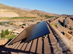 Solar panels being installed on a rooftop, place and date unspecified | Photo courtesy of Legend Solar, St. George News