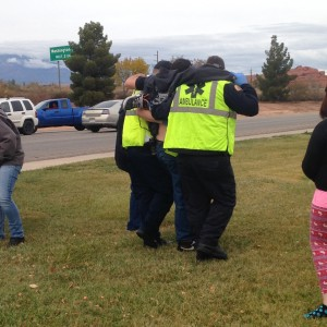 Emergency Responders help a motorcycle rider to the Gold Cross Ambulance for transport to the hospital, St. George, Utah, Dec. 5, 2014 | Photo by Holly Coombs, St. George News