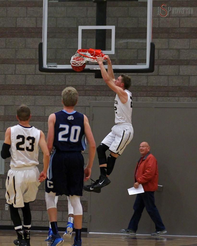 Thunder F Quincy Mathews takes the opening tip in for a dunk, Desert Hills vs. Centennial, Nev, Boys Basketball, St. George, Utah, Dec. 2, 2014 | Photo by Robert Hoppie, ASPpix.com, St. George News