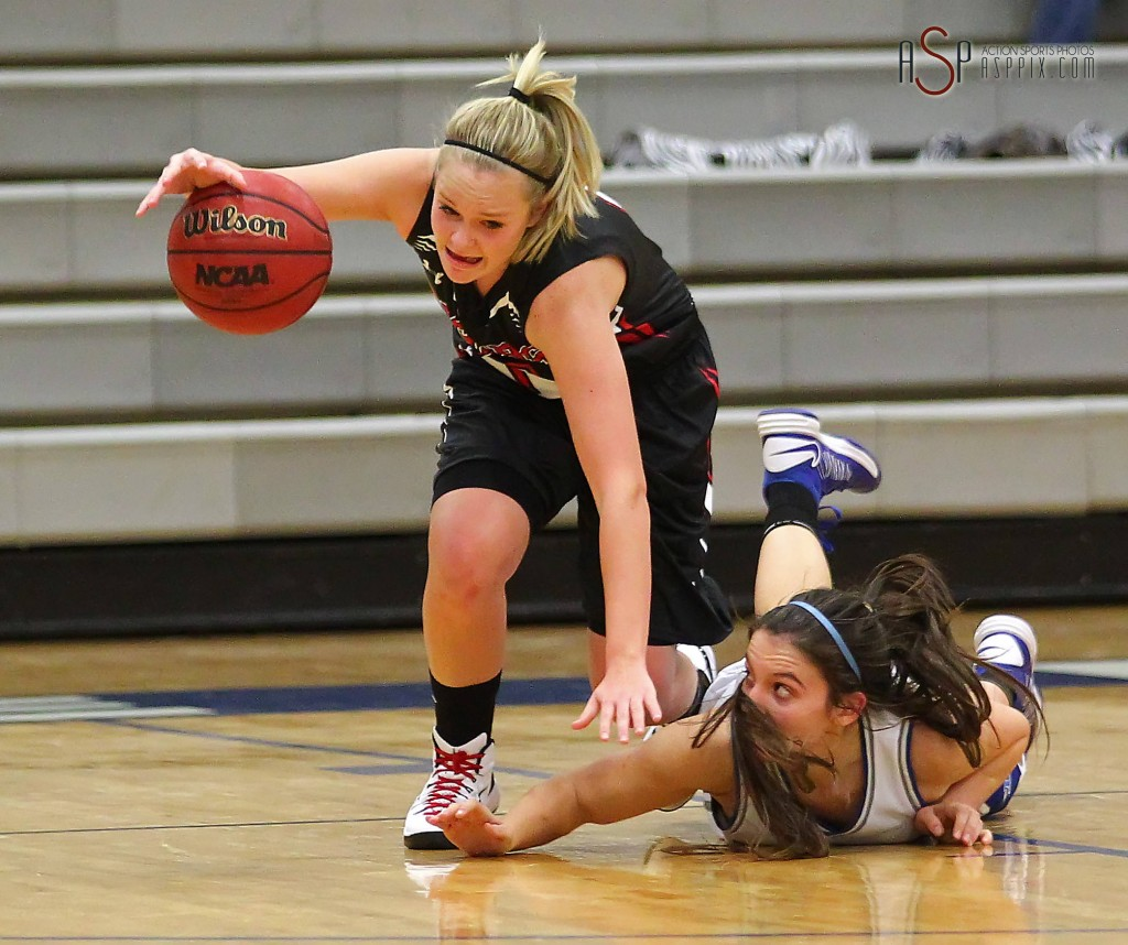 Tiger G London Steglich fights for a tough rebound against Dixie's Taylor Whitson, Dixie vs. Hurricane, Girls Basketball, St. George, Utah, Dec. 9, 2014   Photo by Robert Hoppie, ASPpix.com, St. George NewsDixie vs. Hurricane, Girls Basketball, St. George, Utah, Dec. 9, 2014   Photo by Robert Hoppie, ASPpix.com, St. George News