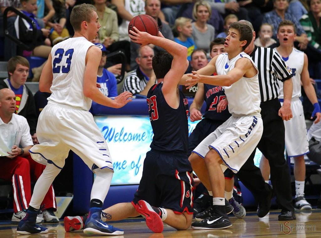 Jake Hawes (23) and Tyler Bennett defend against a Springville player, Dixie vs. Springville, Boys Basketball, St. George, Utah, Dec. 12, 2014 | Photo by Robert Hoppie, ASPpix.com, St. George News