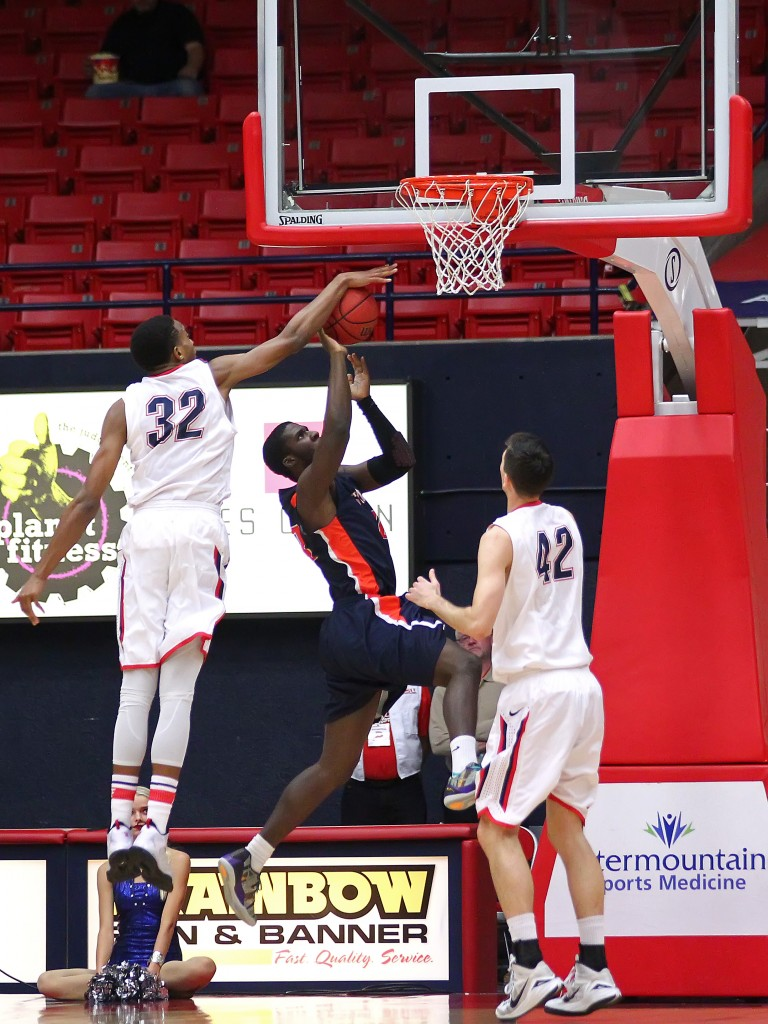Mark Ogden (32) with a block of a Fresno Pacific player, Dixie State University vs. Fresno Pacific University, Mens Basketball, St. George, Utah, Dec. 13, 2014 | Photo by Robert Hoppie, ASPpix.com, St. George News